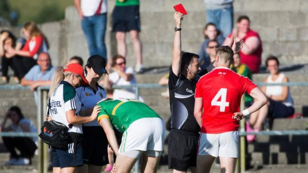 Louth's James Craven receives a red card from referee Noel Mooney. Photograph: Evan Logan/Inpho