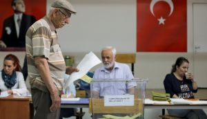 A man casts his ballot for Turkey's presidential and parliamentary elections at a polling station in Ankara. Photograph: Stoyan Nenov/Reuters