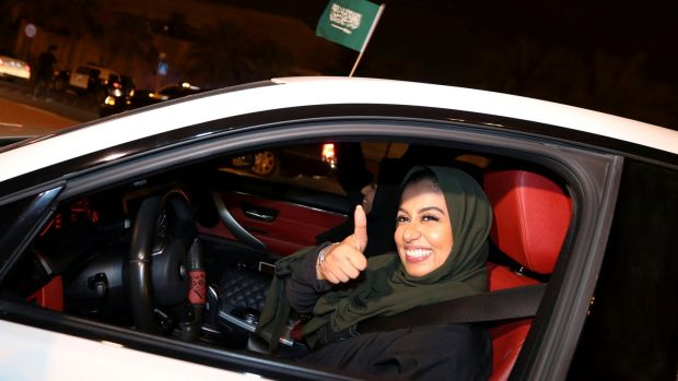 A Saudi woman celebrates as she drives her car in her neighborhood, in Al Khobar, Saudi Arabia. Photograph: Hamad I Mohammed/Reuters