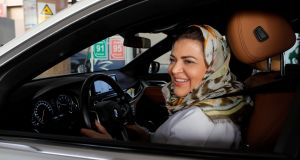 Dr Samira al-Ghamdi, a practicing psychologist, drives her car out in her neighborhood while going to work, in Jeddah, on Sunday. Photograph: Zohra Bensemra/Reuters