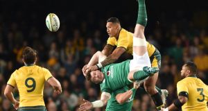 Israel Folau challenges Peter O'Mahony in the air, an incident which led to a yellow card for the Australian back. Photograph: Peter Parks/AFP/Getty