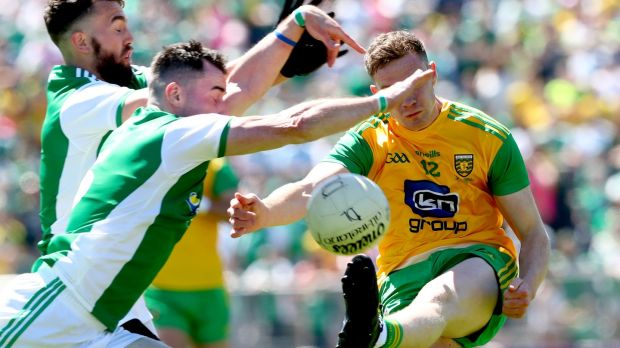 Fermanagh's James McFadden and Barry Mulroe block Ciarán Thompson of Donegal during the Ulster SFC Final at St Tiernach's Park in Clones. Photograph: James Crombie/Inpho