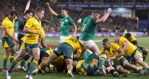 Ireland players celebrating after  CJ Stander  scores a try against Australia.   Photograph: Craig Golding/Reuters