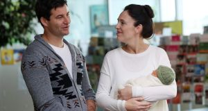 New Zealand prime minister Jacinda Ardern and her partner Clarke Gayford  with their baby daughter Neve Te Aroha   in hospital in Auckland. Photograph: Michael Bradley/AFP/Getty Images