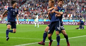 Japan's Keisuke Honda   celebrates with team-mate Yuya Osako after scoring the equaliser  to level the game 2-2. Photograph:  Clive Rose/Getty Images