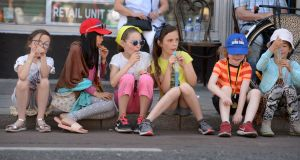 Anna Callaghy, Keira Ho, Lilly Mooney, Ruby Callaghy, Danny Mooney and Hazel Ho cool off at the Stoneybatter Festival, in Dublin on Sunday. Photograph: Dara Mac Dónaill