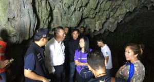 Narongsak Osatanakorn, the governor of Chiang Rai  province, talks to his staff on Saturday at the entrance to the cave where a group of boys and their football coach are missing. Photograph: Chiang Rai city public affairs department via AP