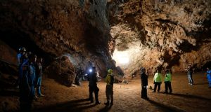 Rescue teams gather in a deep cave on Monday where a group of boys went missing at the weekend. Photograph: Krit Promsakla Na Sakolnakorn/Thai News Pix via AP