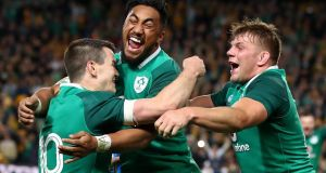 Ireland's Bundee Aki  celebrating with  Johnny Sexton and Jordi Murphy after they won  the third test match against  Australia  in Sydney. Photograph:  Cameron Spencer/Getty Images
