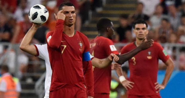 Portugal s Cristiano Ronaldo reacts to receiving a yellow card. Photograph   Getty Images ca4b2bfd1