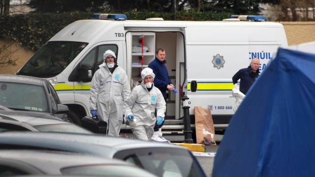 Gardaí outside Cumiskey's pub on Blackhorse Avenue on December 31st, 2015, after Darren Kearns was shot dead the previous night in the car park. File photograph: Colin Keegan/Collins Dublin