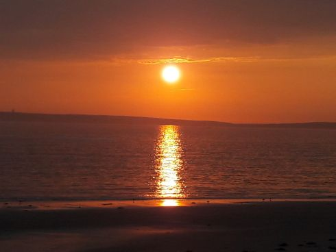 Sunset over Mutton Island, from Seafield Beach, Quilty, West Clare. Photograph: Martin Carey