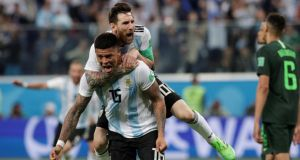 Argentina's Marcos Rojo celebrates scoring their second goal with Lionel Messi during the 2018 World Cup Group D clash in St Petersburg. Photo: Henry Romero/Reuters