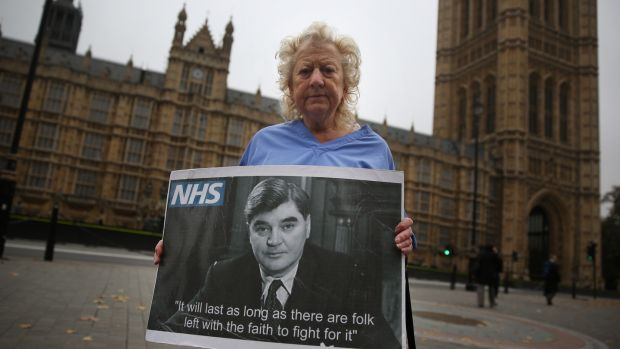 "Campaigner June Hautot holds a photo of Aneurin ""Nye"" Bevan, who spearheaded the establishment of the National Health Service (NHS).Photograph: Peter Macdiarmid/Getty Images"