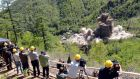 Observers watch the demolition of a nuclear test site in Punggye-ri, North Korea, on May 24th. Photograph: AFP/KCNA via KNS