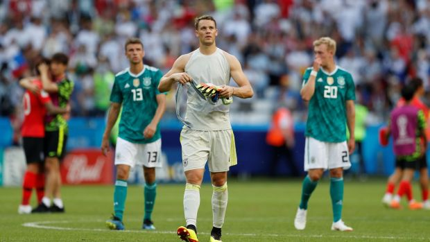 Germany's Manuel Neuer leaves the pitch dejected they crashed out of the 2018 World Cup with a Group F loss to South Korea. Photo: John Sibley/Reuters