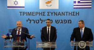 Israeli defence minister Avigdor Lieberman, Cypriot defence minister Savvas Angelides  and Greek defence minister Panos Kammenos. Photograph: Yiannis Kourtoglou/Reuters