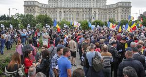 Protesters gather outside the parliament in Bucharest on Wednesday during a no-confidence vote in the government, which it defeated. Photograph: Octav Ganea via Reuters