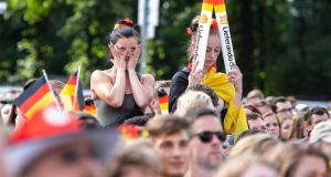 German fans react as they watch their team get knocked out of the World Cup in the group stages. Photo: Omer Messinger/EPA