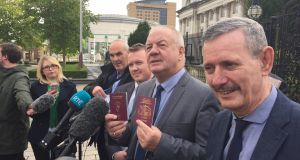 Victims campaigner Raymond McCord displays Irish passport together with his British passport last year. File photograph: Gerry Moriarty