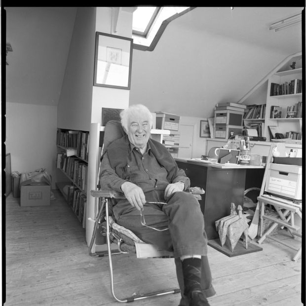 In the Attic: Seamus Heaney in his study at the family home in Sandymount, in Dublin. The Heaney family have loaned his desk to the National Library for the exhibition Seamus Heaney: Listen Now Again. Photograph © Bobbie Hanvey; courtesy National Library of Ireland