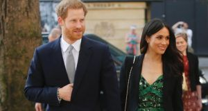 Prince Harry and Meghan Markle: Markle used the elevate formula when she wore a high street green floral Self Portrait dress mixed  with a Roland Mouret bag and Alexander McQueen blazer. Photograph: Getty Images