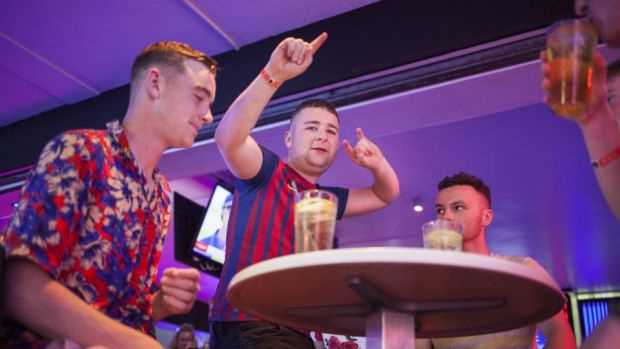 Magaluf: a group at a bar on the Strip. Photograph: Tomeu Coll