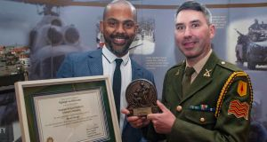 Sgt Richard Muldarry after  receiving his Defence Forces Values Champions Award, with his husband, Levino de Oliveira, at The Curragh Camp, Co Kildare.