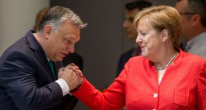 "Hungarian prime minister Viktor Orban and German chancellor Angela Merkel:  ""Hungary will not become an immigrant country; Hungary will remain a Hungarian country,"" said Mr Orban. Photograph: Stephanie Lecocq"