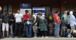 Refugees wait for a special train in Freilassing, southern Germany, in September 2015 after they were taken off express trains from Hungary and Austria. Photograph: Christof Stache/AFP/Getty Images