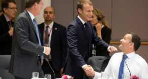 French president Emmanuel Macron greeting Taoiseach Leo Varadkar during a breakfast meeting at the EU summit in Brussels. Photograph: AP Photo/Virginia Mayo