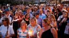 Mourners stand in silence during a vigil in response to a shooting at the Capital Gazette newsroom on Friday in Annapolis. Photograph: Patrick Semansky/AP