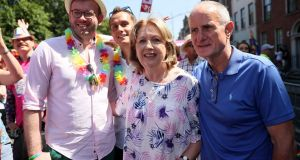 Former president  Mary McAleese with her husband Martin  and her son Justin (second left) and his husband Fionan (l) during the Dublin Pride Parade. Photograph: Brian Lawless/PA Wire