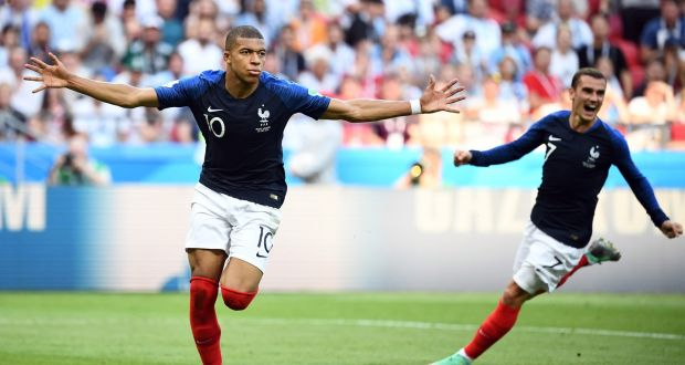 a1939696e France forward Kylian Mbappe celebrates with team-mate Antoine Griezmann  after scoring their fourth goal