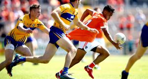 Armagh's Jemar Hall is held back during the All-Ireland Senior Football Championship qualifier against Clare at the Athletic Grounds in Armagh. Photograph: Ryan Byrne/Inpho