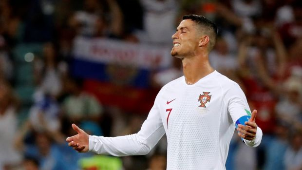 Cristiano Ronaldo reacts to a missed chance. Photograph: Toru Hanai/Reuters