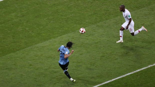 Uruguay's Edinson Cavani sweeps home his second goal. Photograph: Sergio Perez/Reuters