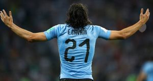 Edinson Cavani  celebrates scoring against Portugal. Photograph: Julian Finney/Getty Images