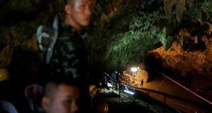 Soldiers and rescue workers work in the Tham Luang cave complex. Photograph: REUTERS/Soe Zeya Tun