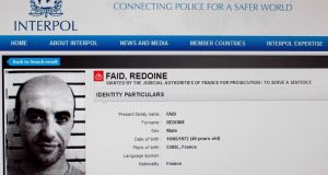 A reproduction of the Interpol website shows the international wanted person notice for French rober Redoine Faid. Image: Interpol/AFP/Getty Images.