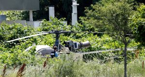 A helicopter  abandoned by French armed robber Redoine Faid after his escape from prison in Reau near Paris. Photograph: Geoffroy Van Der Hassel/AFP/Getty Images.