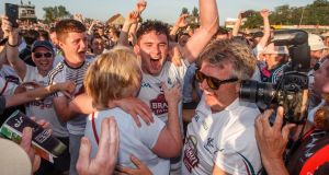 Kildare's David Hyland celebrates with his mother Maire after the All-Ireland SFC Round 3 qualifier win over Mayo at  St Conleth's Park in Newbridge. Photograph: James Crombie/Inpho