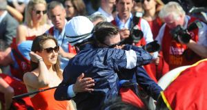 Trainer Joseph O'Brien embraces his brother Donnacha O'Brien after they combined with Latrobe to win theDubai Duty Free Irish Derby at the Curragh. Photograph: Inpho