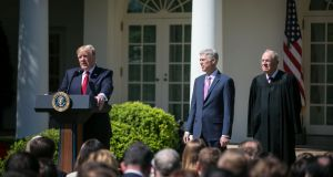 US president Donald Trump with supreme court judges Neil Gorsuch and Anthony Kennedy at the Rose Garden of the White House in Washington last year. File photograph: Al Drago/The New York Times