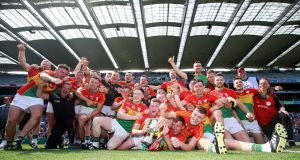 Carlow celebrate their Joe McDonagh Cup Final victory over Westmeath at Croke Park. Photograph: Tommy Dickson/Inpho