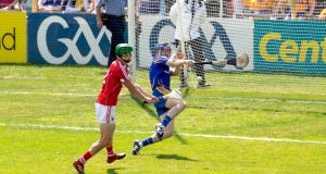Cork's Seamus Harnedy scores a goal past Clare's goalkeeper Donal Tuohy during the Munster SHC final at Semple Stadium. Photo: Morgan Treacy/Inpho