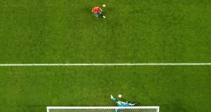 Igor Akinfeev saves from Iago Aspas. Photo: Carl Recine/Reuters