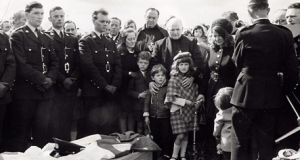 Garda Richard Fallon's family surrounded by mourners at his funeral in 1970. Photograph: Fallon family