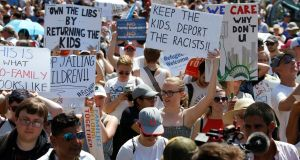 Immigration activists hold up signs during rally to protest against the Trump administration's immigration policy outside the White House in Washingtonon Saturday. Photograph: Joshua Roberts/Reuters