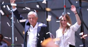 Presidential candidate Andres Manuel Lopez Obrador  with his wife Beatriz Gutierrez Muller as he addresses supporters in Mexico City. Photograph: Goran Tomasevic/Reuters